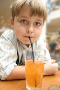 boy-drinking-soda-through-straw-201x300