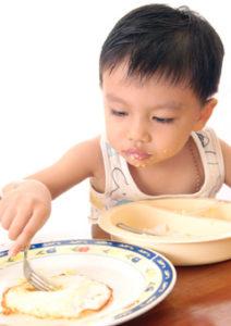 boy-eating-a-fried-egg