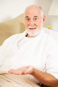 old-man-taking-pills